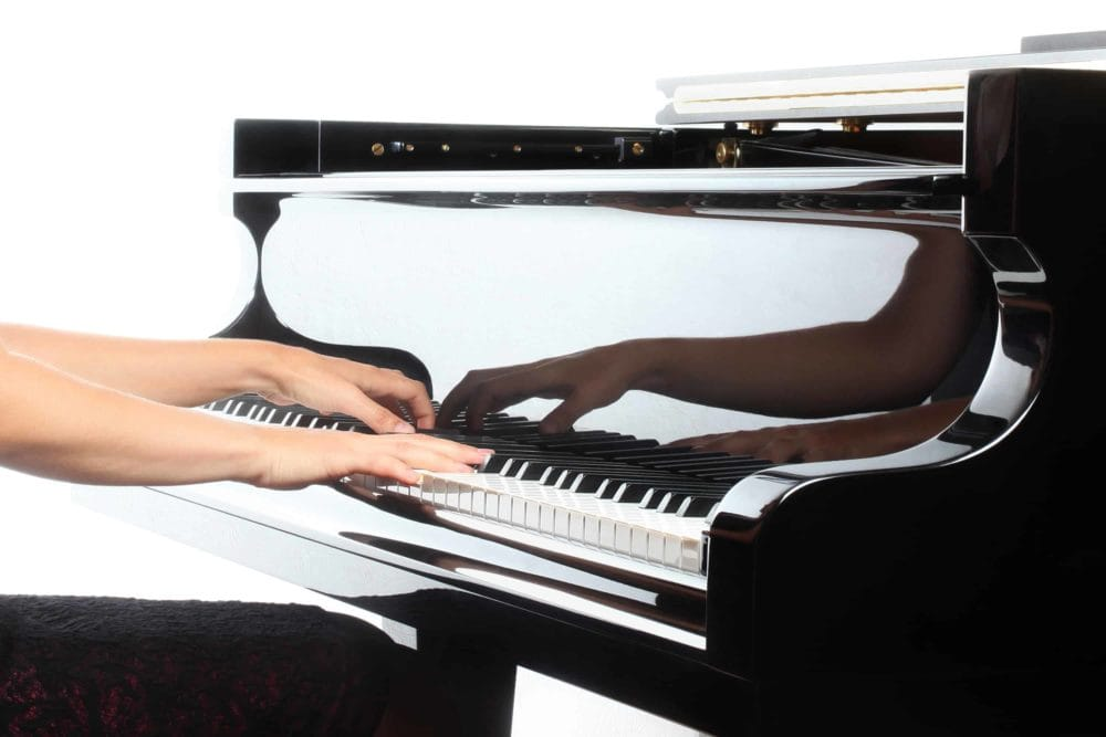 Hands Playing a Grand Piano
